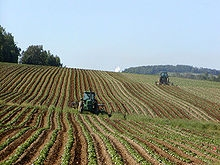 220px-Tractors_in_Potato_Field.jpg